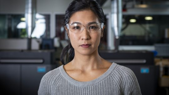 woman with protective goggles looking confidently and directly at the camera